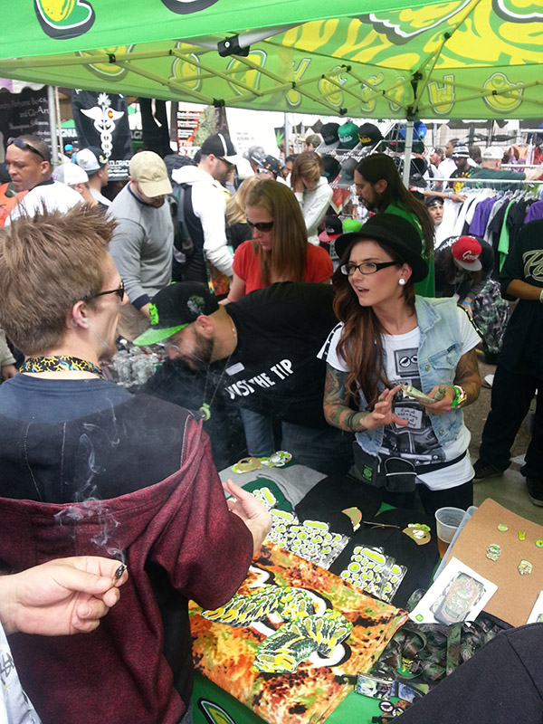 One vendor attending to a member of the crowd.